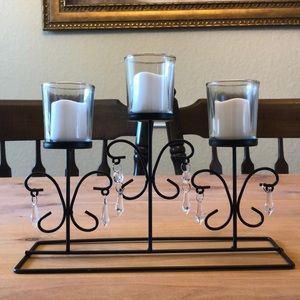 Candle holder with candles.